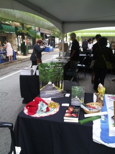 Here's my book sales booth at Printers Row Book fest in Chicago in June.  Note the fuzzy slippers, hankie and candy representing assisted living! People loved it. My good friend Stephanie Medlock was next to me selling her book The Lives of Things.